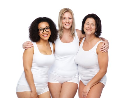 friendship, beauty, body positive and people concept - group of happy plus size women in white underwear Imagens - 61683027