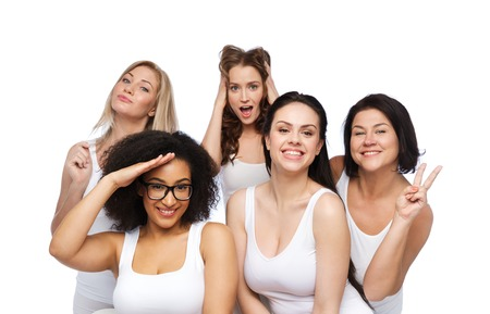 friendship, beauty, body positive and people concept - group of happy plus size women in white underwear having fun and making faces