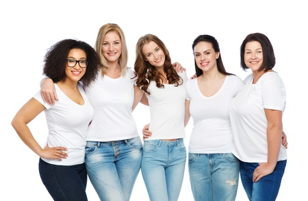friendship, diverse, body positive and people concept - group of happy different size women in white t-shirts hugging Stock Photo