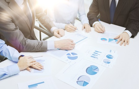 chats: business and office concept - close up of business team with chats and graphs in office Stock Photo