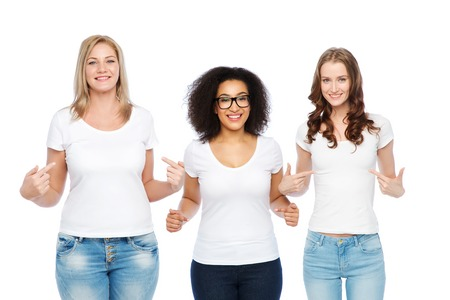 middle: friendship, diverse, body positive and people concept - group of happy different size women in white t-shirts pointing finger to themselves