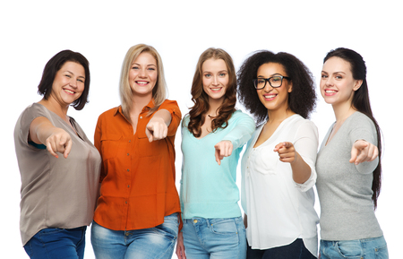 choice, friendship, fashion, diverse people concept - group of happy plus size women in casual clothes pointing finger on you