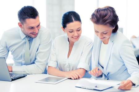 common goal: business team working with tablet pc and laptop in office Stock Photo