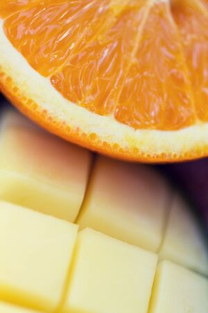 healthy eating, food, fruits and diet concept - close up of fresh juicy orange and mango slices