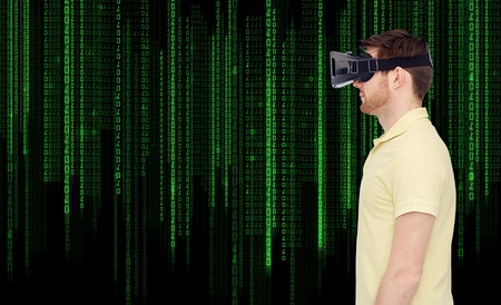 mediated: 3d technology, virtual reality, entertainment and people concept - young man with virtual reality headset or 3d glasses over binary system code background