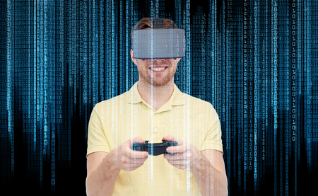 game over: 3d technology, virtual reality, programming, entertainment and people concept - happy young man with virtual reality headset playing with game controller gamepad over binary code and black background
