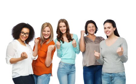 white achievement: gesture, success, friendship, body positive and people concept - group of happy different size women in casual clothes celebrating victory