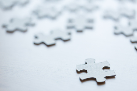 business puzzle: business and connection concept - close up of puzzle pieces on table