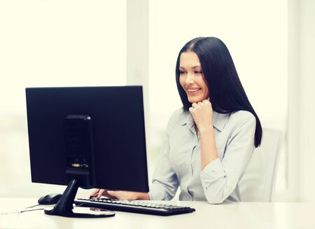 internet education: office, business, education, technology and internet concept - smiling businesswoman or student with computer