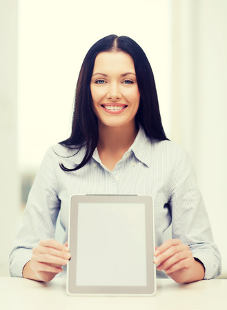 internet education: business, education, technology and internet concept - smiling businesswoman or student with tablet pc computer Stock Photo