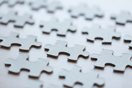 disconnection: business and connection concept - close up of puzzle pieces on table
