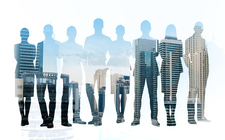 white collar: business, teamwork and people concept - business people silhouettes over city background with double exposure effect