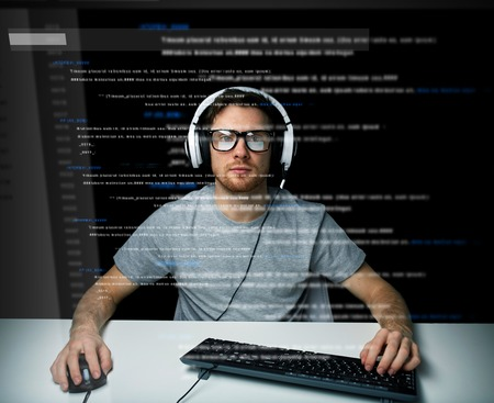web developer: technology, cyberspace, virtual reality and people concept - man or hacker in headset and eyeglasses with keyboard hacking computer system or programming over vitual screen projection