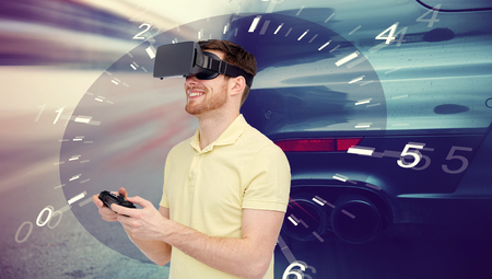mediated: 3d technology, virtual reality, entertainment and people concept - happy man in virtual reality headset with game controller gamepad playing car racing game over tachometer and street race background