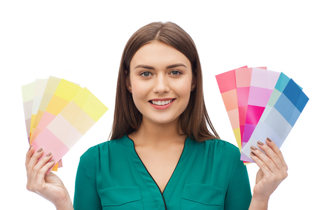swatch: color scheme, decoration, design and people concept - smiling young woman with color swatches or samples