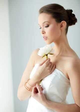 bride bangle: beauty, jewelry, people and luxury concept - beautiful asian woman or bride in white dress with peony flower, golden ring and bracelet