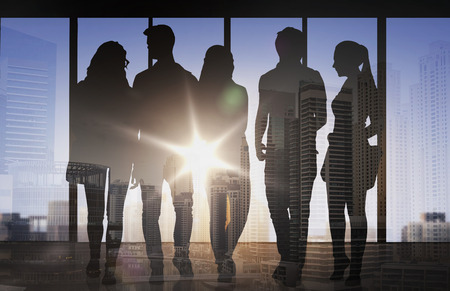multiple exposure: business, education, travel, tourism and people concept - people silhouettes over double exposure office or city airport background Stock Photo