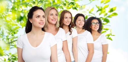 friendship, diverse, body positive and people concept - group of happy different size women in white t-shirts over green natural background