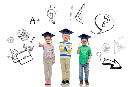 elementary: childhood, school, education, knowledge and people concept - happy children in bachelor hats or mortarboards and eyeglasses over doodles