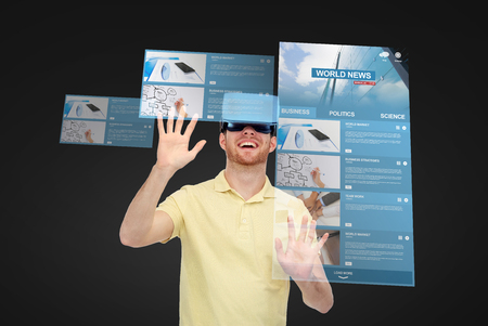 mediated: 3d technology, virtual reality, internet, mass media and people concept - happy young man in virtual reality headset or 3d glasses playing game over black background with world news on screens