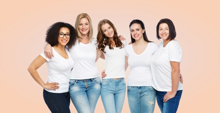 friendship, diverse, body positive and people concept - group of happy different size women in white t-shirts hugging over beige background