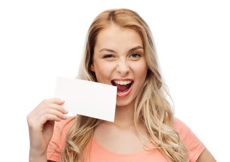 woman holding card: advertisement, invitation, message and people concept - smiling young woman or teenage girl with blank white paper card