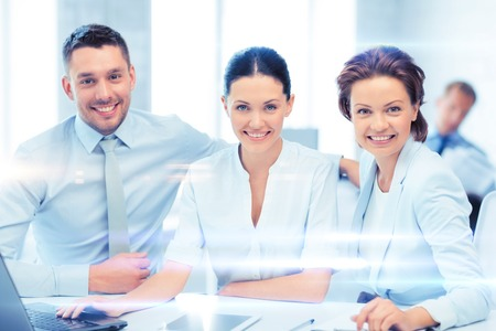 common goal: business concept - business team working with tablet pc and laptop in office