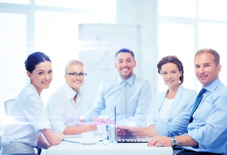 business team: business and office concept - business team having meeting in office