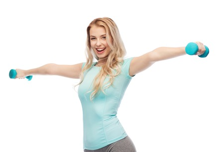 teenage girl: fitness, sport, exercising and people concept - smiling beautiful sporty woman with dumbbell Stock Photo