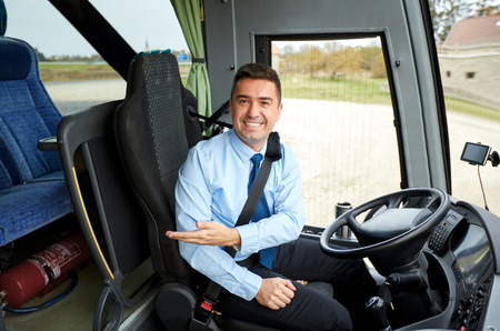 transport: transport, tourism, road trip, gesture and people concept - happy driver inviting on board of intercity bus