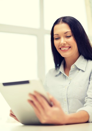 internet education: office, business, education, technology and internet concept - smiling businesswoman or student with tablet pc Stock Photo