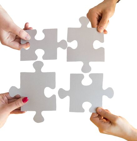 compatibility: business, teamwork, cooperation, compatibility and connection concept - close up of hands connecting puzzle pieces Stock Photo