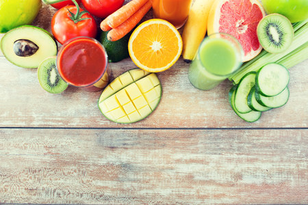 fruits juice: healthy eating, food and diet concept - close up of fresh juice glass and fruits on table