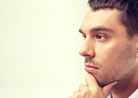 visage homme: affaires, les gens et le concept de travail - gros plan d'affaires visage masculin Banque d'images