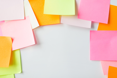reminders: business, information, memo, management and education concept - close up of blank paper stickers on cork board Stock Photo