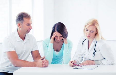 medical cabinet: healthcare and medical concept - doctor with patients in cabinet