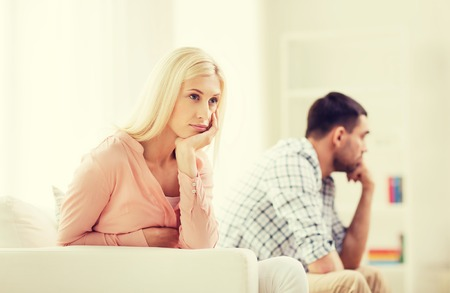 couple fight: people, relationship difficulties, conflict and family concept - unhappy couple having argument at home Stock Photo