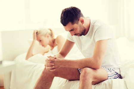 difficulties: people, relationship difficulties, conflict and family concept - unhappy couple having problems at bedroom Stock Photo