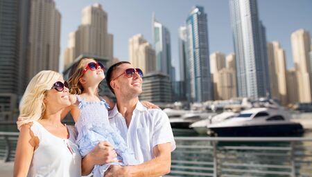middle ages boat: summer holidays, travel, tourism, vacation and people concept - happy family over dubai city street background Stock Photo