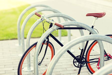 transport, storage and vehicle concept - close up of fixed gear bicycle at street parking outdoors Stock Photo