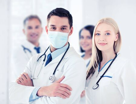 healthcare and medical concept - group of doctors
