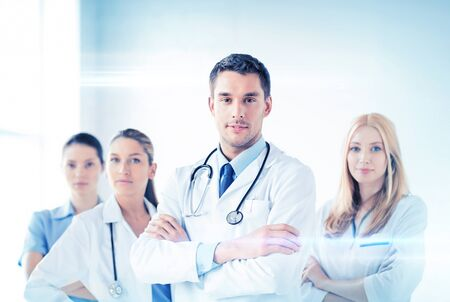 physiotherapists: attractive male doctor in front of medical group Stock Photo