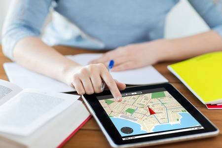 business, location, navigation, technology and internet concept - close up of student woman with gps navigator map on tablet pc computer and notebook at home Imagens - 62066169