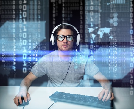 technology, cyberspace, virtual reality and people concept - man or hacker in headset and eyeglasses with keyboard hacking computer system or programming over binary code projection Stock Photo