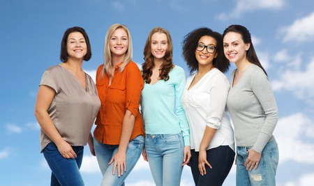 woman clothes: friendship, fashion, body positive, diverse and people concept - group of happy different size women in casual clothes over blue sky and clouds background