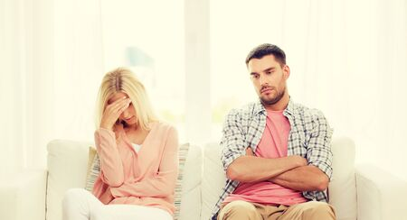 people, relationship difficulties, conflict and family concept - unhappy couple having argument at home Stock Photo