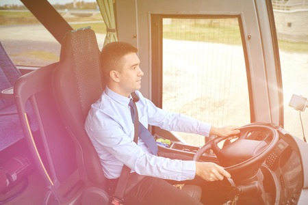 intercity: transport, tourism, road trip and people concept - happy driver driving intercity bus