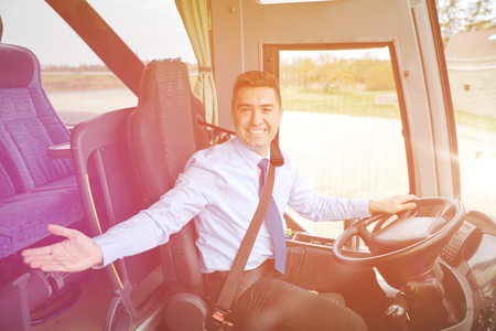 intercity: transport, tourism, road trip, gesture and people concept - happy driver inviting on board of intercity bus
