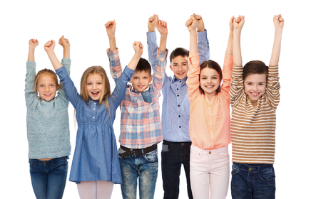 child boy: childhood, fashion, gesture and people concept - happy children friends raising fists and celebrating victory
