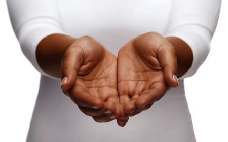 people, charity and poverty concept - close up of african american female empty cupped hands holding and showing something Stockfoto